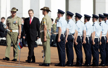 PM of Britain Blair inspects honour guard of Australian defence personnel after arriving at Parliament House in Canberra
