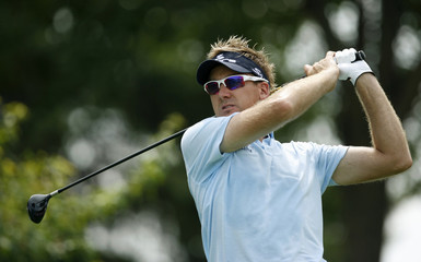 Poulter hits his tee shot on second hole during the 2009 PGA Championship golf tournament in Chaska