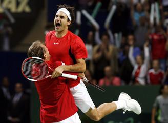 Switzerland's Federer and Allegro celebrate winning their Davis Cup World Group playoff doubles match against Serbia & Montenegro in Geneva