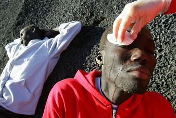 Would-be African immigrants receive treatment after arriving to Spain's Canary Island of Fuerteventura.