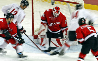 Switzerland's Gerber makes save during win over Canada in men's ice hockey game at Torino 2006 Winter Olympic Games