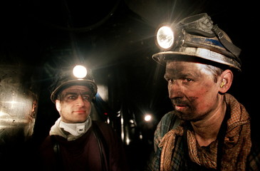 "- PHOTO TAKEN 07APR04 - French coal miners of the ""La Houve"" mine shaft have a break as they work in.."