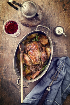 Coq au Vin with Vegetable in Burgundy Sauce as top view in a Casserole