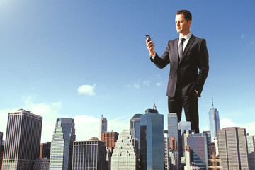 Huge businessman using smartphone