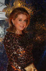 French actress Catherine Deneuve poses as she arrives at the 16th Damascus International Film Festival