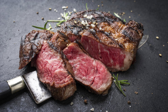 Barbecue aged Wagyu Rib Eye Steak as close-up on slate