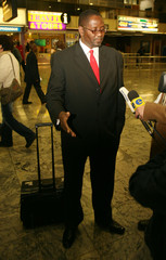 COSATU General Secretary Zwelinzima Vavi arrives at Johannesburg international airport after being denied entry to Zimbabwe