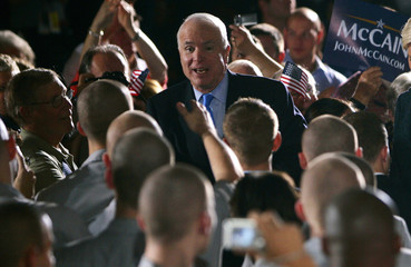 Republican presidential candidate U.S. Senator John McCain (R-AZ) walks through a group of cadets as he arrives for a campaign stop at The Citadel in Charleston, South Carolina