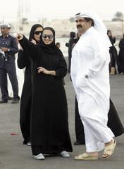 Qatar's Emir Sheikh Hamad bin Khalifa al-Thani and his family look at the torch  in Ruwais
