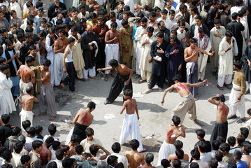PAKISTANI SHIITE MUSLIMS BEAT THEMSELVES WITH KNIFES IN RAWALPINDI.