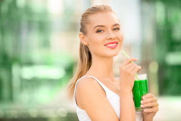 Young woman drink smoothie healthy detox outdoors