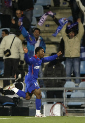 Getafe's Ikechuwku Uche celebrates his second goal against Real Madrid during their Spanish first division soccer match in Getafe