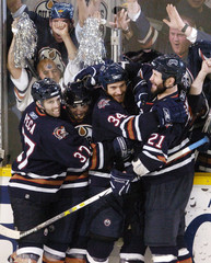 Oilers celebrate after goal by Pisani in Edmonton