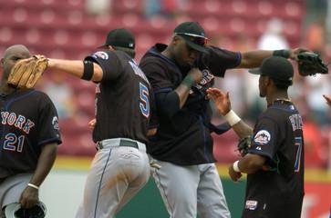 New York Mets' David Wright, Cliff Floyd and Jose Reyes celebrate after win over the Cincinnati Reds in Cincinnati, Ohio