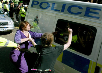WOMEN SHOUT ABUSE AS MAXINE CARR LEAVES PETERBOROUGH MAGISTRATES COURTIN A POLICE VEHICLE.