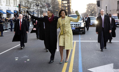President Barack Obama and first lady Michelle Obama walk down Pennsylvania Avenue enroute to the White House