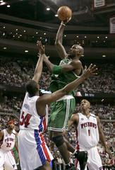Boston Celtics Kevin Garnett goes up to shoot under pressure from Detroit Pistons defenders Jason Maxiell and Chauncey Billups in Auburn Hills