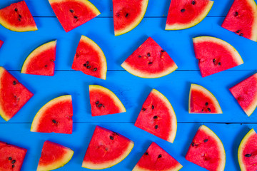 Watermelon on blue rustic wood background