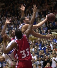 DUKE'S BOOZER IS FOULED AS HE DRIVES TO THE BASKET.