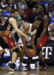 Orlando Magic forward Rashard Lewis pitches out of a double team by Toronto Raptors forwards Hedo Turkoglu and Chris Bosh  in Orlando.