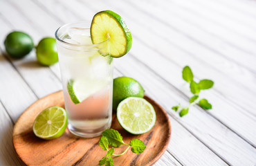Refreshing lime drink with ice cubes in a glass jar