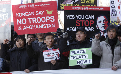 Anti-war activists chant slogans during a rally near the U.S. embassy in Seoul