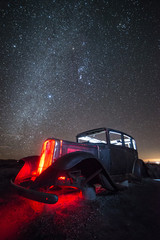 Rusty, Abandoned Car on Route 66 Under Winter Night Sky, Petrified Forest National Park, Arizona