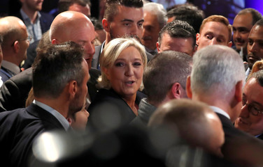 Marine Le Pen, French National Front political party candidate for French 2017 presidential election, greets supporters at the Chalet du Lac in the Bois de Vincennes in Paris after her defeat in the second round of 2017 French presidential election