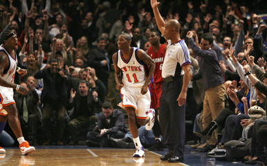 Knicks guard Crawford and center Curry react  in the fourth quarter of their NBA basketball game in New York