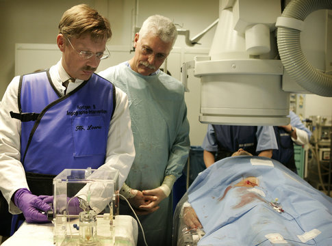 Radiologist Reiser and nuclear physician Tatsch operate on a cancer patient by the new radiation treatment for liver tumours SIRT in Munich's university hospital