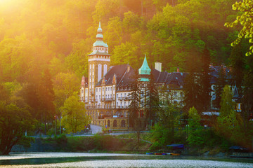 Lillafured palace in Miskolc, Hungary with sun shining. Lake Hamori in foreground. Travel outdoor hipster landmark background