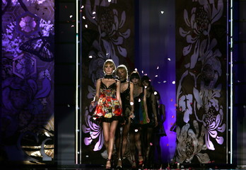 Models present creations as part of Just Cavalli Fall/Winter 2006/07 women's collection during Milan..