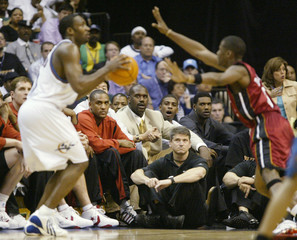 Heats O'Neal watches from the bench during Eastern Conference semifinals against the Wizards in Washington.