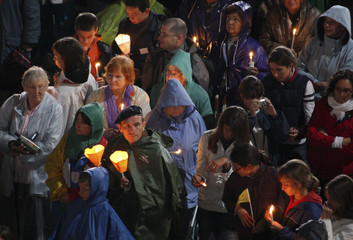 Roman Catholic faithful take part in the Marian Procession of Light at the Rosary Basilica in the Sanctuary of Lourdes