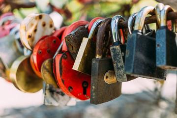 Many love locks or padlocks, selective focus, copy space