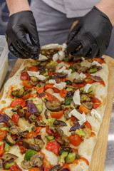 Chef preparing pizza, closeup