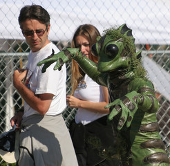 Michael Jackson fans look at a man dressed up in a frog suit in front of the Santa Maria courthouse in ...