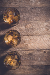 Whiskey glasses on an old wooden table. Top view