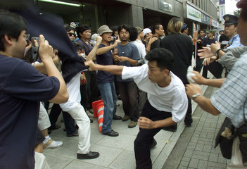 JAPANESE RIGHT-WING NATIONALIST ATTACKS LEFTISTS OUTSIDE YASUKUNISHRINE IN TOKYO.
