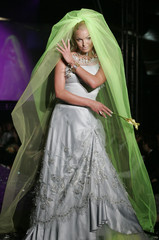 Russian ballerina Anastasia Volochkova sports an outfit by Russian designer Alice Tolkacheva during ...