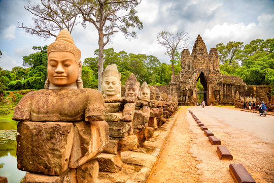 Row of sculptures in the South Gate of Angkor Thom complex. Siem Reap, Cambodia