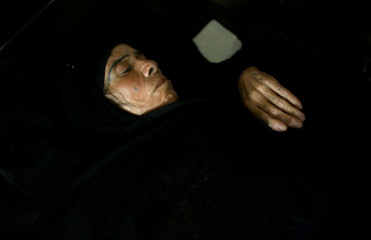 IRAQI WOMAN LIES IN HER BED AT THE SADDAM HOSPITAL IN TIKRIT.