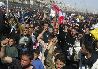 Iraqi Shi'ites chant slogans denouncing Samarra's Golden Mosque bombing during a protest after Friday prayers in Baghdad's Sad'r city
