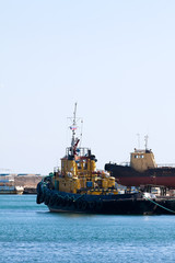 tugboat in the port of sea