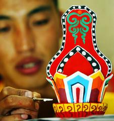 MAN PAINTS TIBETAN ART IN KUALA LUMPUR.