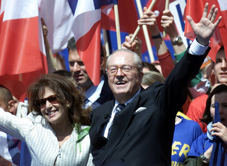 FRENCH NATIONAL FRONT PRESIDENTIAL CANDIDATE JEAN-MARIE LE PEN AND HISWIFE JANY WAVE IN PARIS.