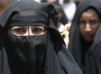 A Shi'ite woman takes part in a religious pilgrimage to the Imam Moussa al-Kadhim shrine in Baghdad