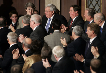 Republican members of the House of Representatives applaud former Speaker of the House Hastert in Washington