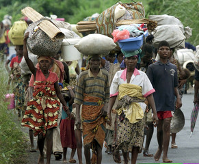 Thousands of Liberian refugees head into Cotton Tree, some 50 km from Monrovia, fleeing fresh fighti..