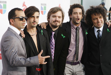 Members of the Venezuelan band Los Amigos Invisibles pose at the 10th annual Latin Grammy awards in Las Vegas